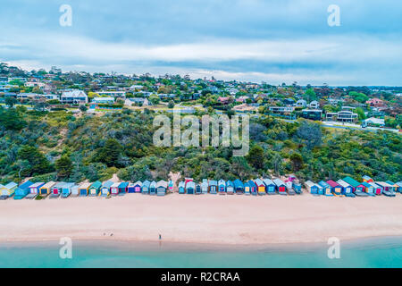 Aerial view of colorful beach huts on Mills Beach in Mornington, Victoria, Australia - Stock Photo