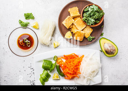 Vegan bun cha salad bowl with sticky tofu, rice noodles and vegetables, flat lay, top view. Plant based diet concept. - Stock Photo