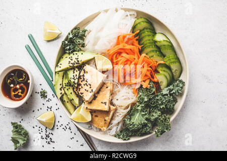 Vegan bun cha salad bowl with sticky tofu, rice noodles and vegetables. Plant based diet concept. - Stock Photo