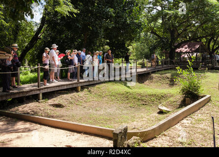 Tourists visiting The Killing Fields Genocidal Centre memorial site where mass graves of Khmer Rouge victims were found Choeung Ek Phnom Penh Cambodia - Stock Photo