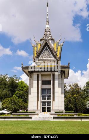 Buddhist Stupa containing human skulls in The Killing Fields Genocidal Centre memorial site. Choeung Ek, Phnom Penh, Cambodia, southeast Asia - Stock Photo