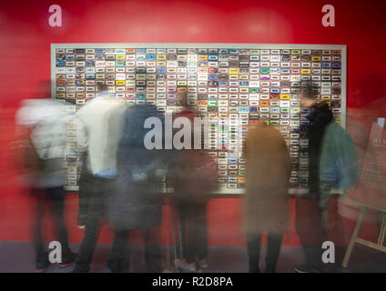 Beijing, China. 18th Nov, 2018. Visitors look at a wall of vintage cassette tapes displayed at a major exhibition to commemorate the 40th anniversary of China's reform and opening-up held at the National Museum of China in Beijing, capital of China, Nov. 18, 2018. The exhibition has attracted more than 190,000 visitors since it opened on Nov. 13. Credit: Cai Yang/Xinhua/Alamy Live News - Stock Photo