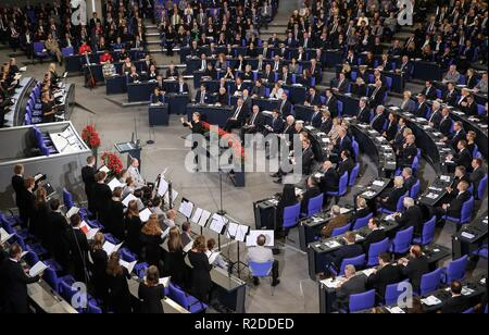 Berlin, Germany. 18th Nov, 2018. Visiting French President Emmanuel Macron attends an event to mark the Day of Mourning at the Bundestag, the German Federal Parliament, in Berlin, capital of Germany, Nov. 18, 2018. Visiting French President Emmanuel Macron on Sunday addressed German legislators, calling for opening a new chapter for Europe and building it more integrated, stronger and independent. Credit: Shan Yuqi/Xinhua/Alamy Live News - Stock Photo