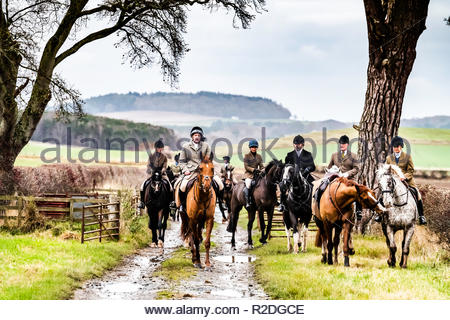 Smailholm, Kelso, Scottish Borders, UK. 19th November 2018. Mounted followers of the Duke of Buccleuch Foxhounds make what they can of a damp Monday near Kelso in the Borders. Credit: Chris Strickland / Alamy Live News - Stock Photo