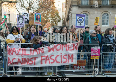 London, UK. 17th Nov, 2018. Protesters are seen holding placards and a banner while listening to the speeches during the protest.Huge crowds seen marching from BBC in Portland Place to Whitehall with flags and placards during the National Unity Demonstration to oppose the rise of fascist and racist activity in Europe, The demonstration was called Unite against Fascism, Love Music Hate Racism and Stand up to racism while the speeches at the Whitehall were disrupted by the presence of a small number of far right activists and Trump supporters. (Credit Image: © Andres Pantoja/SO - Stock Photo