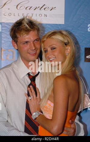 BRIDGEHAMPTON, NY - JULY 03: Paris Hilton, Nick Carter  during PS2 and Jay-Z Celebrate the Launch of the S. Carter Tennis Shoe at Playstation 2 Estate in Bridgehampton, New York,   People:  Paris Hilton, Nick Carter - Stock Photo
