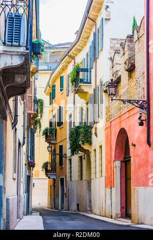 Narrow and colorful street of the historic center. Verona, Veneto, Italy, Europe - Stock Photo