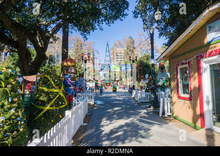 December 6, 2017 San Jose / CA / USA - Alley and exhibits at 'Christmas in the park' event in Plaza de Cesar Chavez, Silicon Valley, south San Francis - Stock Photo
