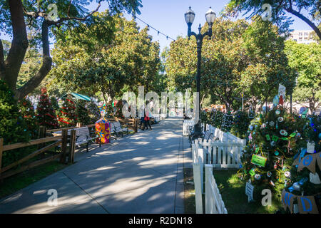 December 6, 2017 San Jose / CA / USA - Alley in 'Christmas in the park' downtown display in Plaza de Cesar Chavez, Silicon Valley, south San Francisco - Stock Photo