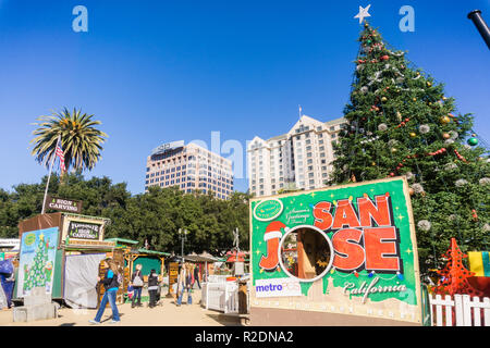 December 6, 2017 San Jose / CA / USA - People entering 'Christmas in the park' downtown display in Plaza de Cesar Chavez, Silicon Valley, south San Fr - Stock Photo