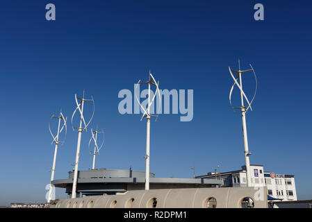 Vertical axis wind turbines on Cleveleys north promenade with blue sky background in lancashire uk - Stock Photo