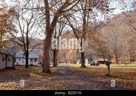 A dirt lane between summer cottages in the fall in Althom, Pennsylvania, USA in November 2018 - Stock Photo