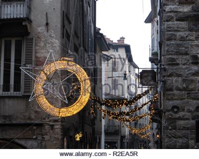 Christmas street decoration between medieval houses in Bergamo Upper Town, Lombardy, Italy - Stock Photo