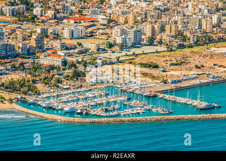 Sea port city of Larnaca, Cyprus. View from the aircraft to the coastline, beaches, seaport and the architecture of the city of Larnaca. - Stock Photo