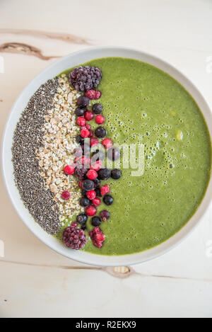 green spinach smoothie bowl - Stock Photo