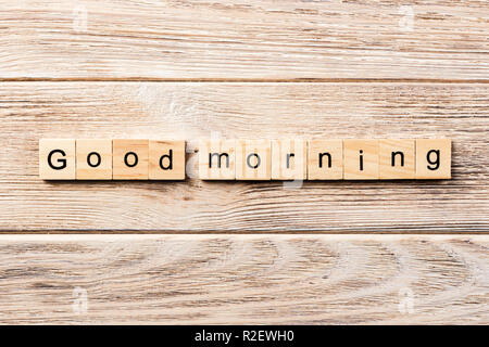 good morning word written on wood block. good morning text on table, concept. - Stock Photo