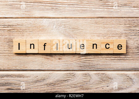 influence word written on wood block. influence text on table, concept. - Stock Photo