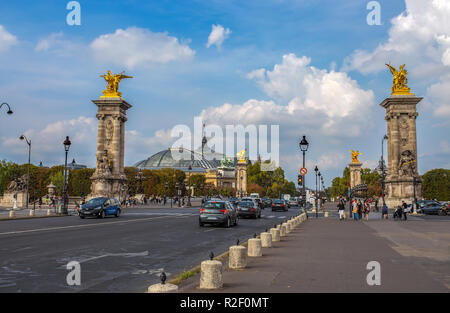 PARIS, FRANCE, SEPTEMBER 5, 2018 - View of Alexander III Bridge over the River Seine, which connects the Grand Palais and the Petit Palais to the Hote - Stock Photo