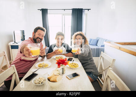 Happy caucasian family mother father son beautiful cheerful happy people having lunch at home together smiling and enjoying. home interior lifestyle concept for group of people with different ages - Stock Photo