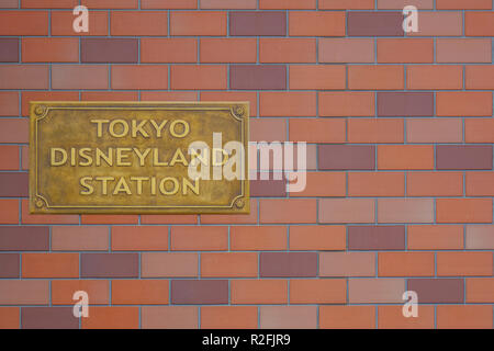 Tokyo Disneyland station sign on the wall at the Disney Resort Line monorail system in Chiba, Japan - Stock Photo
