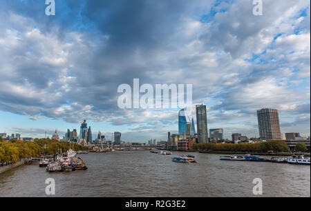 View along the River Thames from Waterloo Bridge towards the City of London skyline including The Shard and St Pauls Cathedral - Stock Photo