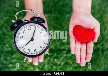 giving love times heart and clock on girl hand. - Stock Photo