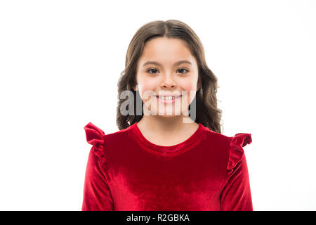 Kid adorable smiling posing in red velvet dress. Kids fashion. Girl cute child wear velvet dress. Velvet dress perfect pick whatever occasion. Feel so trendy in elegant clothes. Fashion concept. - Stock Photo