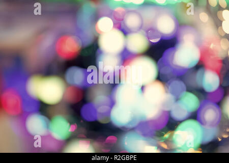 Blur abstract lights with bokeh effect on colorful blurred background. Christmas, new year holidays celebration concept - Stock Photo