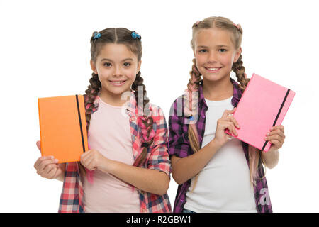 Diary for girls concept. Children cute girls hold notepads or diaries isolated on white background. Note secrets down in your cute girly diary journal. Diary writing for children. Childhood memories. - Stock Photo