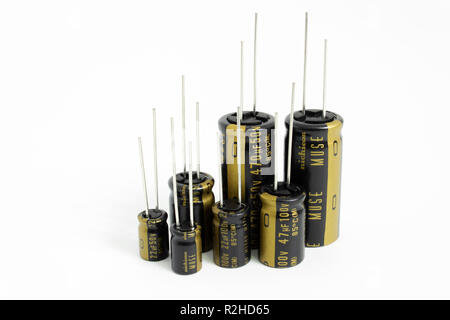 Prague, CZECH REPUBLIC - NOVEMBER 17, 2018: High quality audio grade Japanese aluminium electrolytic capacitors Nichicon MUSE laid on white background - Stock Photo