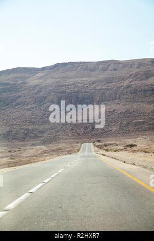 Empty Road Along Dead Sea Coast in Israel - Stock Photo