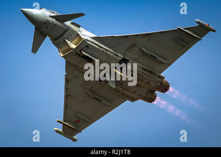 Italian Air force Eurofighter Typhoon in flight. A twin-engine, canard-delta wing, multirole fighter. Photographed at Royal International Air Tattoo ( - Stock Photo