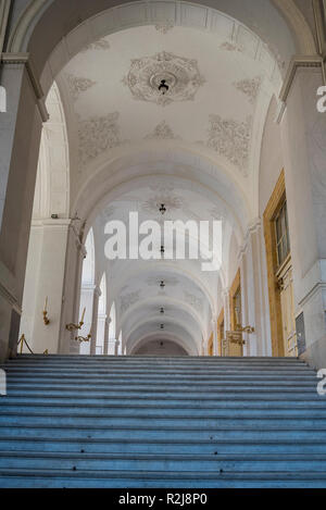 Naples, Italy 25 October 2018 beautiful white interior of the lobby with its magnificent staircase. Baroque and neoclassical Royal Palace in Naples - Stock Photo