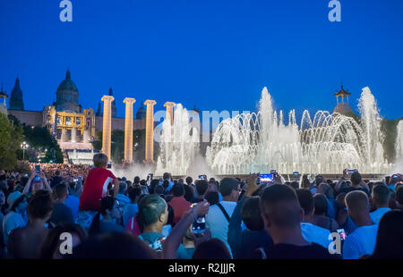 Barcelona, Spain - August 5, 2018: The famous Magic Fountain light show at night. Plaza Espanya in Barcelona, Spain - Stock Photo