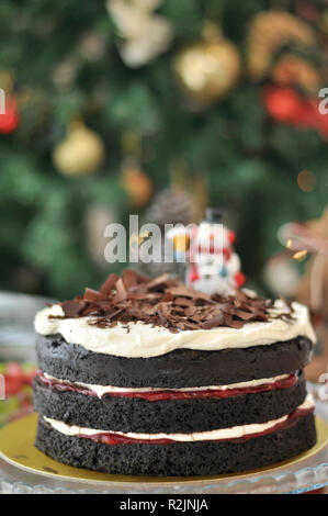 Black Forest Cake with chocolate pieces on top special designed for Christmas, new year and birthday celebrations - Stock Photo