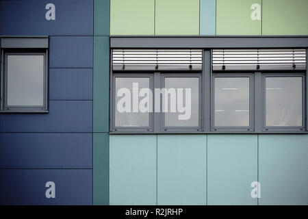 Modern facade of an office building with rows of windows and metal jalousies, - Stock Photo