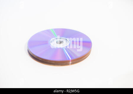 Pile of DVDs recordable DVDs CD CDs DVDR on a white background - Stock Photo