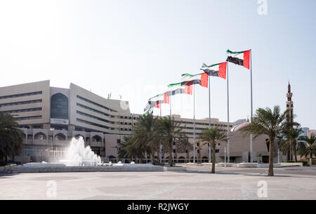 UAE Flag in a row at the front of Abu Dhabi Muncipility - Stock Photo