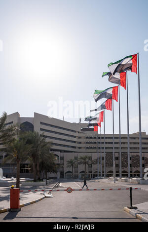 UAE Flag in a row at the front of Abu Dhabi Municipality - Stock Photo