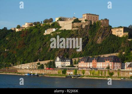Fortress Ehrenbreitstein with Rhine and excursion steamer at dusk, Koblenz, Rhineland-Palatinate, Germany - Stock Photo