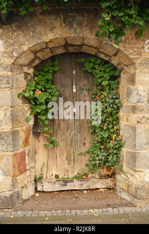 old wooden door in the city wall, Hildesheim, Lower Saxony, Germany, Europe - Stock Photo