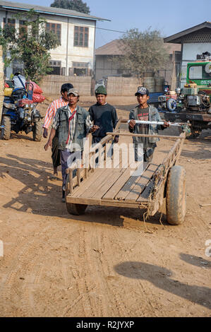 Men with a cart at the marketplace Heho,  Kalaw Township, Taunggyi District, Shan State of Myanmar - Stock Photo