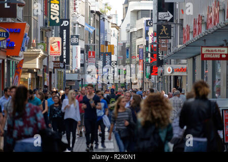 Germany, North Rhine-Westphalia, Cologne, downtown, pedestrian area, the shopping street Hohe Straße, people shopping - Stock Photo