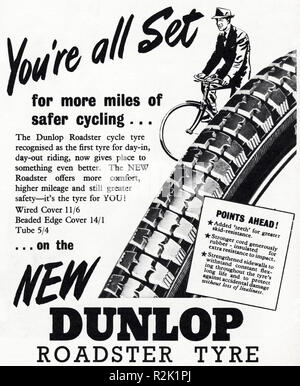 Original 1950s vintage old print advertisement from English magazine advertising Dunlop Roadster tyre circa 1954 - Stock Photo