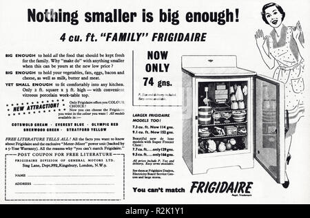 Original 1950s vintage old print advertisement from English magazine advertising Frigidaire refrigerator circa 1954 - Stock Photo