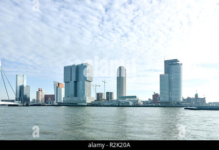 Rotterdam, district 'Head of South', seen from the Veerhaven, with the Erasmus Bridge (Ben van Berkel 1992-1997), and the Rotterdam (OMA, 2002-2014), the largest building of Netherlands, to the right the tower New Orleans (Alvaro Siza , 2008-2013), highest residential tower of Netherlands and double tower World Port Center (Norman Foster, 1997-2003) - Stock Photo