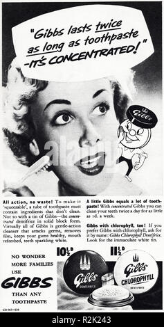 Original 1950s vintage old print advertisement from English magazine advertising Gibbs toothpaste circa 1954 - Stock Photo