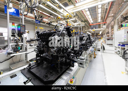 Assembly of motor vehicle. Robotic equipment makes Assembly of car. Modern car Assembly at factory - Stock Photo