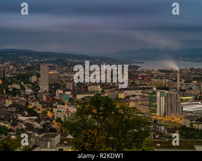 View over Zurich in the evening with Lake Zurich - Stock Photo