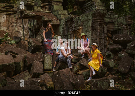 Group of tourists in the ruins of the temple  Ta Prohm.  Siem Reap, Cambodia. - Stock Photo